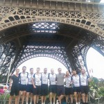 The team in front of the Eiffel Tower