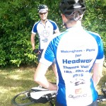 Two of the team in their Headway jerseys