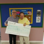Andrew presenting a cheque to Stephen Welch, CEO. Andrew raised money for Headway by taking part in the Green Park Challenge